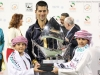 djokovic-with-trophy-and-kids-32