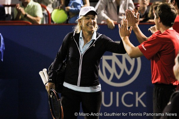Martina Navratilova high fivea a ballboy