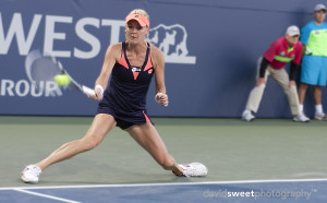 Aga Radwanska slides to a ball