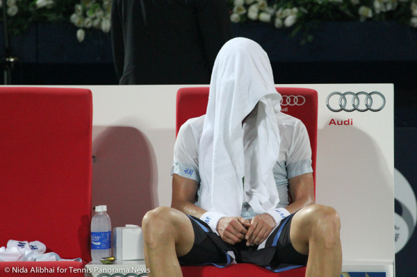 Berdyh with towel over his head