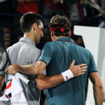 Djokovic and Federer hug