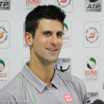 Djokovic smiling in press