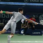 Djokovic stretch 1-handed bh