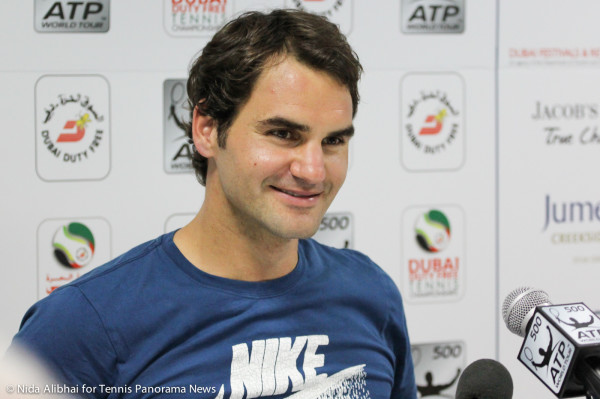 Federer smiles in press