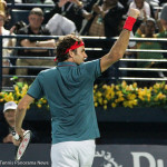 Federer wins and raises fist