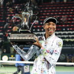 Venus smiles with trophy