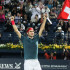 Federer wins with arms raised