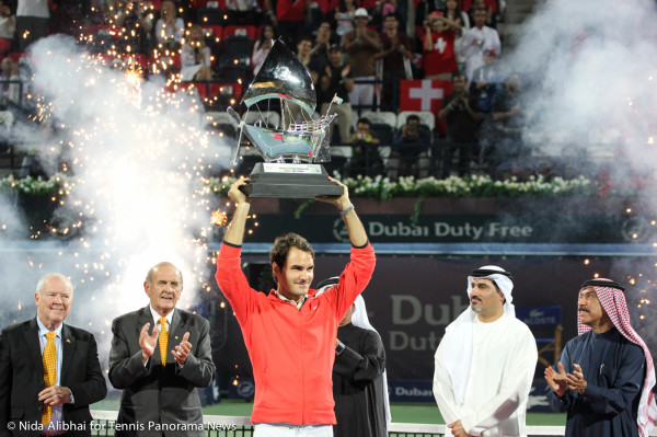 Federer with trophies and fireworks