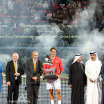 Federer with trophy and tournament organizers