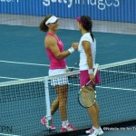 Li and Stosur shake hands