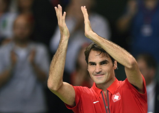 Switzerland's Roger Federer claps after beating Kazakhstan's Andrey Golubev during the Davis Cup World Group quarter-final match Switzerland vs Kazakhstan on April 6, 2014 in Geneva. Roger Federer put Switzerland into the Davis Cup semi-finals when he beat Andrey Golubev 7-6 (7/6), 6-2, 6-3 for a 3-2 win over Kazakhstan. AFP PHOTO / FABRICE COFFRINI        (Photo credit should read FABRICE COFFRINI/AFP/Getty Images)