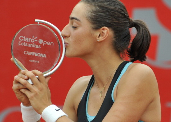 French tennis player Caroline Garcia kisses her trophy after beating Serbia's player Jelena Jankovic in the final match of the WTA Bogota Open, in the Colombian capital, on April 13, 2014. AFP PHOTO / Guillermo LEGARIA        (Photo credit should read GUILLERMO LEGARIA/AFP/Getty Images)