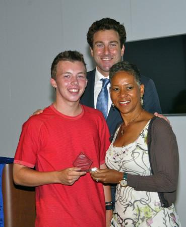 Junior player Matthew Gamble receives his award from Justin Gimelstob and Katrina Adams at the Junior Awards Gala on Day 1 at the US Open.