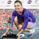 221 Dubai Halep with trophy on ground-001