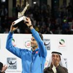228 Djokovic holds up trophy-001