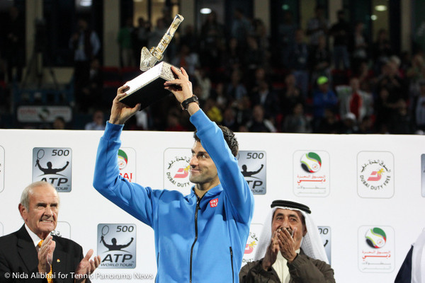 228 Djokovic holds up trophy-001