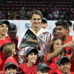 228 Federer with ballkids-001